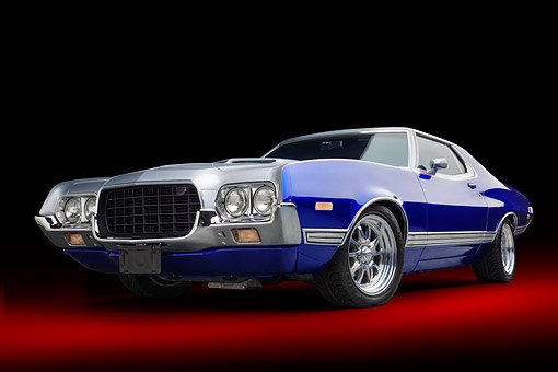 AUT 23 BK0510 01 © Kimball Stock 1972 Ford Gran Torino Sport 2-Door Hardtop Silver And Ford Bronco Blue Low 3/4 Front View In Studio