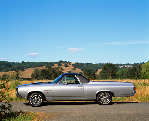 AUT 23 RK0044 01 © Kimball Stock 1970 Chevrolet El Camino SS 454 Silver Profile On Pavement Hills Blue Sky