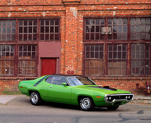 AUT 23 RK0082 03 © Kimball Stock 1971 Green Plymouth Road Runner 3/4 Front View On Pavement By Brick Building