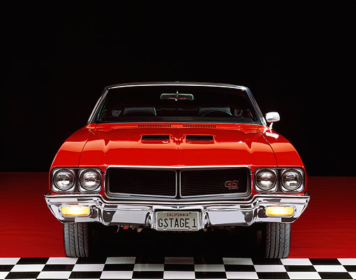 AUT 23 RK0092 03 © Kimball Stock 1970 Buick GS 455 Stage 1 Convertible Red Head On Shot Parking Lights On Checkerboard And Red Floor