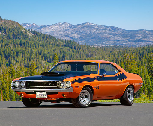 AUT 23 RK0118 11 © Kimball Stock 1971 Dodge Challenger 440 6-Pac Orange And Black 3/4 Front View On Pavement