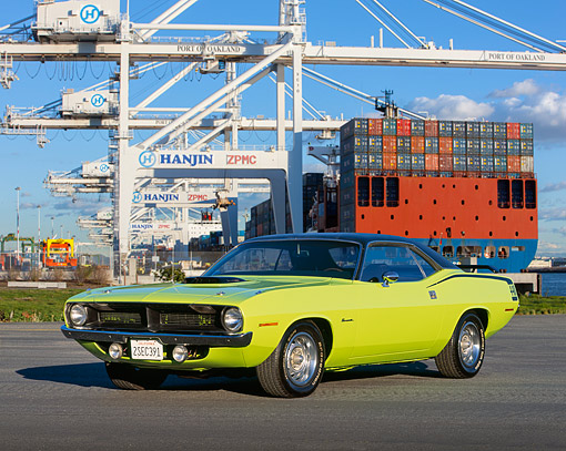 AUT 23 RK0135 04 © Kimball Stock 1970 Plymouth Barracuda 440 Six Pack Green 3/4 Front View On Pavement By Shipping Port