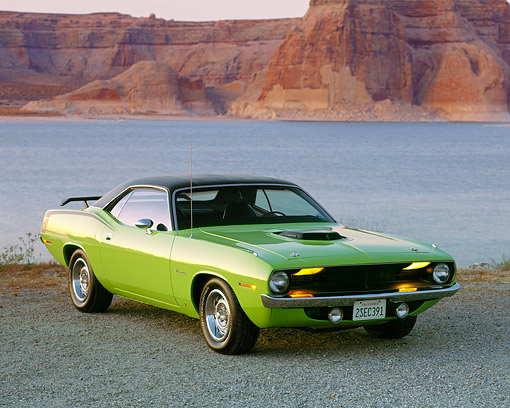 AUT 23 RK0137 02 © Kimball Stock 1970 Plymouth Barracuda 440 Six Pack Green 3/4 Front View By Water