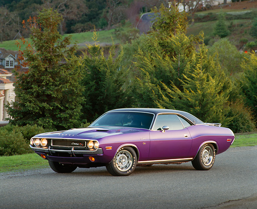 AUT 23 RK0163 03 © Kimball Stock 1970 Dodge Challenger Plum Crazy 3/4 Side View On Pavement By Trees Headlights On