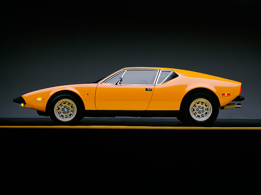 AUT 23 RK0257 01 © Kimball Stock 1973 De Tomaso Pantera Orange Side View On Gray Line Studio