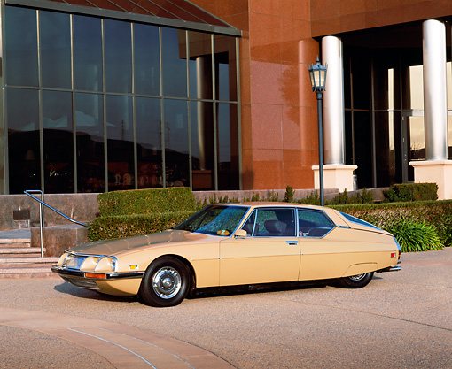 AUT 23 RK0341 02 © Kimball Stock 1972 Citroen Maserati SM Tan 3/4 Side View On Pavement By Museum