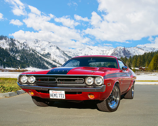 AUT 23 RK0532 01 © Kimball Stock 1971 Dodge Challenger 426 Hemi Red And Black Low 3/4 Front View On Pavement Cloudy Blue Sky