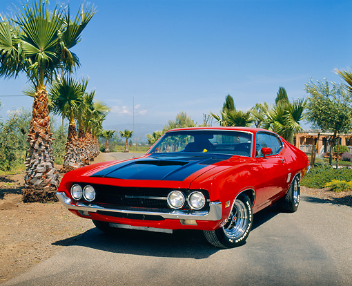 AUT 23 RK0534 02 © Kimball Stock 1970 Ford Torino Red And Black 3/4 Front View On Pavement By Palm Trees