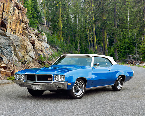 AUT 23 RK0587 02 © Kimball Stock 1970 Buick GS 455 Convertible Blue White Top Front 3/4 View oN Pavement By Trees