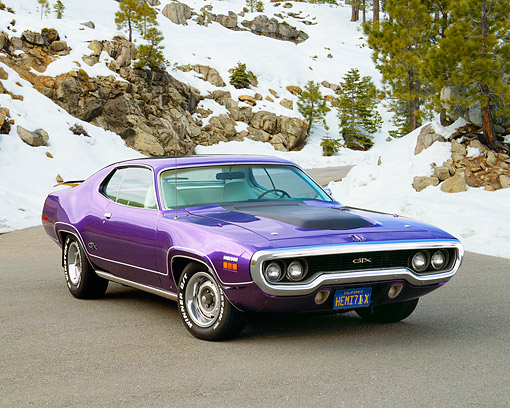 AUT 23 RK0606 01 © Kimball Stock 1971 Plymouth Hemi GTX Purple 3/4 Front View On Pavement By Trees And Snow
