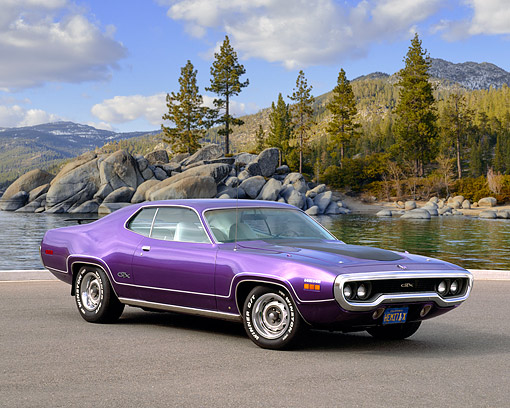 AUT 23 RK0608 02 © Kimball Stock 1971 Plymouth Hemi GTX Purple 3/4 Side View On Pavement By Trees