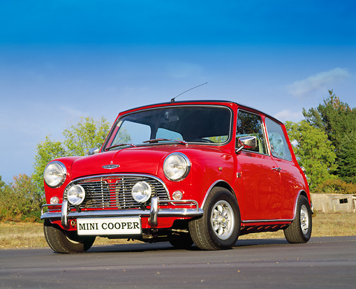 AUT 23 RK0676 01 © Kimball Stock 1971 Austin Mini Cooper Red Black Top Low 3/4 Front View On Pavement