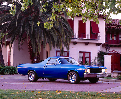AUT 23 RK0742 02 © Kimball Stock 1971 Chevy El Camino Blue Low 3/4 Side View By Spanish Building And Trees