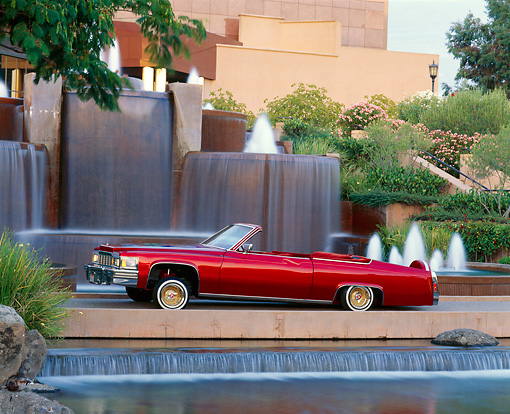 AUT 23 RK0777 02 © Kimball Stock 1977 Cadillac Coupe Deville Convertible Red Side View On Water Fountains