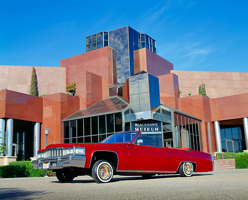 AUT 23 RK0786 01 © Kimball Stock 1977 Cadillac Coupe Deville Convertible Red Low 3/4 Side View On Pavement By Museum