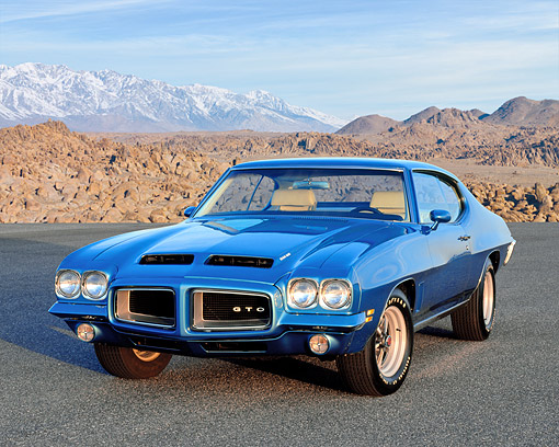 AUT 23 RK0842 01 © Kimball Stock 1972 Pontiac GTO 455 Blue 3/4 Front View On Pavement By Mountains