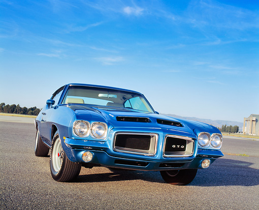 AUT 23 RK0843 03 © Kimball Stock 1972 Pontiac GTO 455 Blue Low 3/4 Front View On Pavement