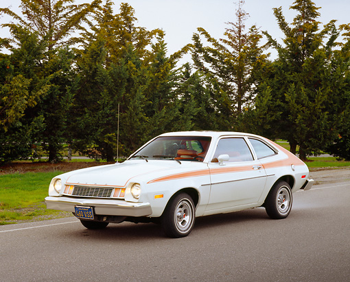 1978 Ford Pinto White And Orange 3 4 Front View On Pavement By Trees