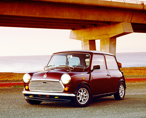 AUT 23 RK0988 03 © Kimball Stock 1972 Austin Mini Cooper Burgundy 3/4 Front View On Pavement By Bridge
