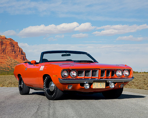 AUT 23 RK1075 01 © Kimball Stock 1971 Plymouth Hemi Barracuda Convertible Rallye Red Low 3/4 Front View On Pavement