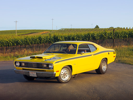 AUT 23 RK1182 01 © Kimball Stock 1972 Plymouth Duster Yellow 3/4 Front View On Pavement