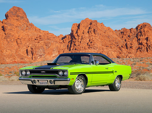 AUT 23 RK1237 01 © Kimball Stock 1970 Plymouth GTX Green 3/4 Front View On Pavement