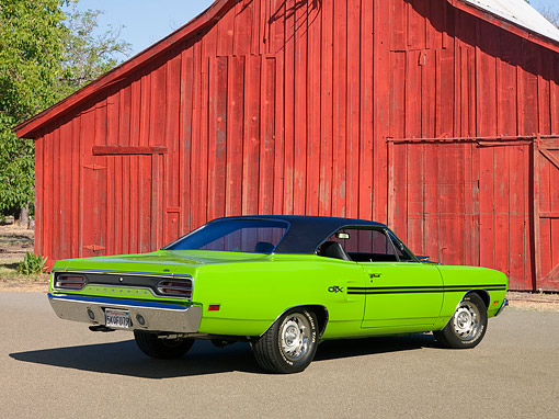 AUT 23 RK1243 01 © Kimball Stock 1970 Plymouth GTX Green 3/4 Rear View On Pavement