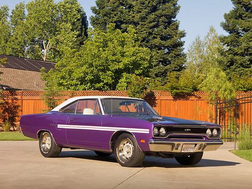 AUT 23 RK1253 01 © Kimball Stock 1970 Plymouth GTX Purple Low 3/4 Front View On Pavement