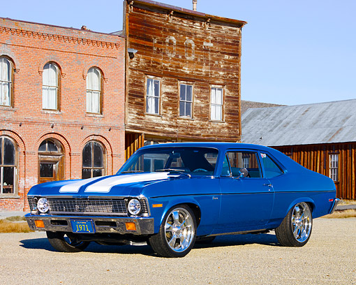 AUT 23 RK1604 01 © Kimball Stock 1971 Chevrolet Nova Blue 3/4 Front View On Gravel By Ghost Town