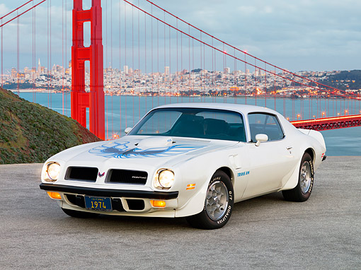 AUT 23 RK1636 01 © Kimball Stock 1974 Pontiac Trans Am White 3/4 Front View On Pavement By Bridge