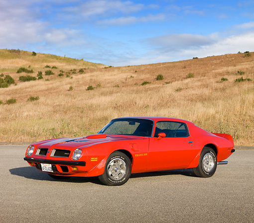AUT 23 RK1824 01 © Kimball Stock 1974 Pontiac Firebird Trans Am Red 3/4 Front View On Pavement By Hills