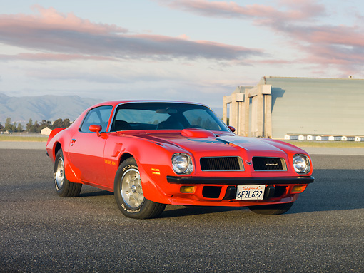 AUT 23 RK1825 01 © Kimball Stock 1974 Pontiac Firebird Trans Am Red 3/4 Front View On Pavement