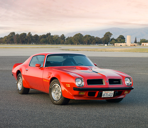 AUT 23 RK1827 01 © Kimball Stock 1974 Pontiac Firebird Trans Am Red 3/4 Front View On Pavement