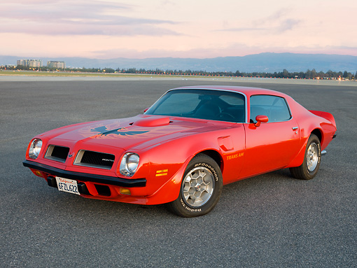 AUT 23 RK1829 01 © Kimball Stock 1974 Pontiac Firebird Trans Am Red 3/4 Front View On Pavement
