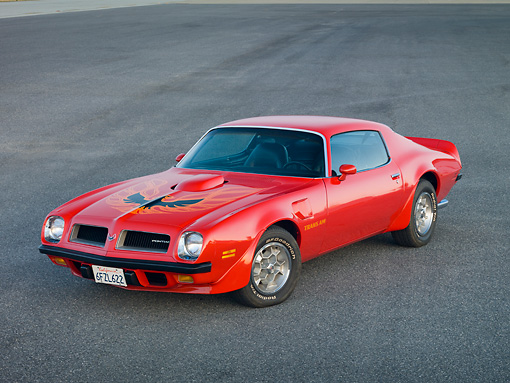 AUT 23 RK1830 01 © Kimball Stock 1974 Pontiac Firebird Trans Am Red 3/4 Front View On Pavement
