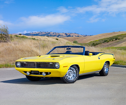 AUT 23 RK1859 01 © Kimball Stock 1970 Plymouth Barracuda 383 Convertible Yellow 3/4 Front View On Pavement By Hills