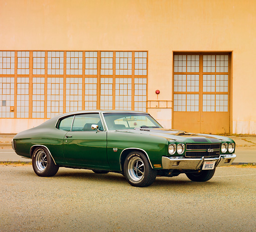 AUT 23 RK1871 01 © Kimball Stock 1970 Chevrolet Chevelle SS 454 Green 3/4 Front View On Pavement By Building