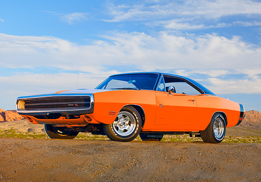 AUT 23 RK1909 01 © Kimball Stock 1970 Dodge Charger R/T Orange And Black 3/4 Front View On Dirt Hill