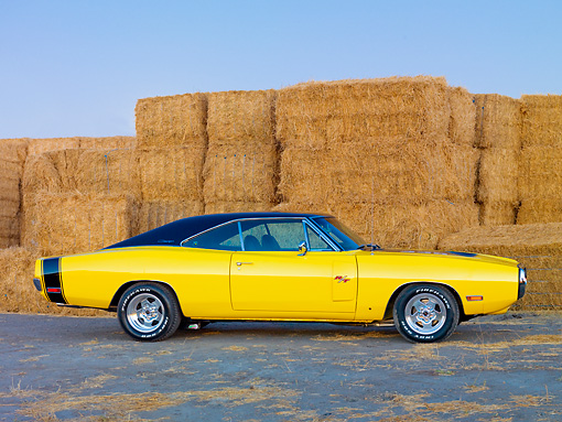 AUT 23 RK1911 01 © Kimball Stock 1970 Dodge Charger R/T Yellow And Black Profile View On Dirt By Straw Bales