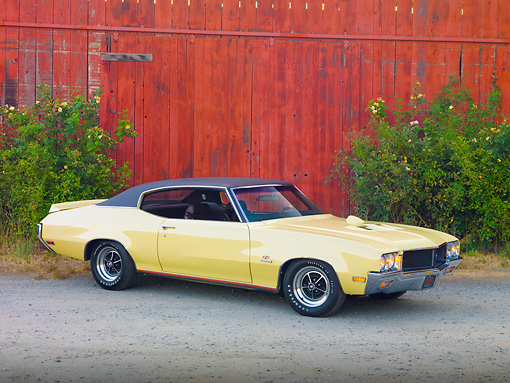 AUT 23 RK1928 01 © Kimball Stock 1970 Buick GS Stage 1 Beige 3/4 Front View On Pavement By Barn