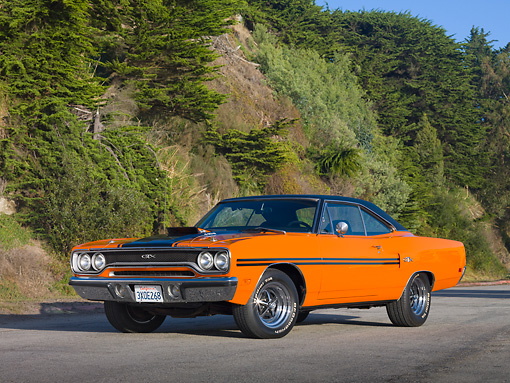 AUT 23 RK1937 01 © Kimball Stock 1970 Plymouth GTX Six Pac Orange And Black 3/4 Front View On Pavement By Hillside