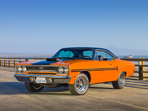 AUT 23 RK1939 01 © Kimball Stock 1970 Plymouth GTX Six Pac Orange And Black 3/4 Front View On Pavement By Ocean