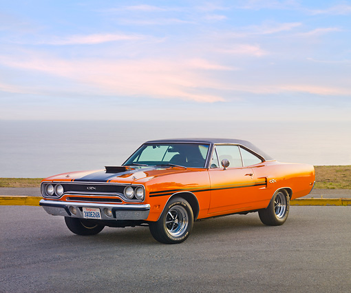 AUT 23 RK1940 01 © Kimball Stock 1970 Plymouth GTX Six Pac Orange And Black 3/4 Front View On Pavement By Ocean