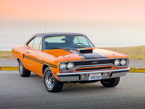 AUT 23 RK1941 01 © Kimball Stock 1970 Plymouth GTX Six Pac Orange And Black 3/4 Front View On Pavement By Ocean