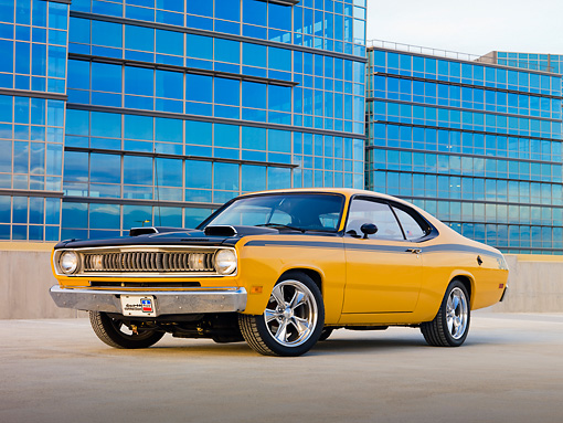 AUT 23 RK1960 01 © Kimball Stock 1971 Plymouth 340 Duster Bahama Yellow With Buildings