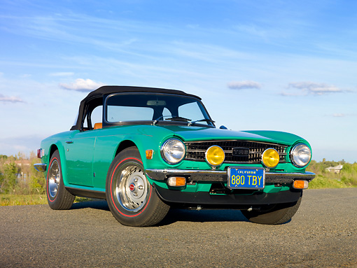 AUT 23 RK1972 01 © Kimball Stock 1975 Triumph TR6 Green 3/4 Front View On Road By Marsh