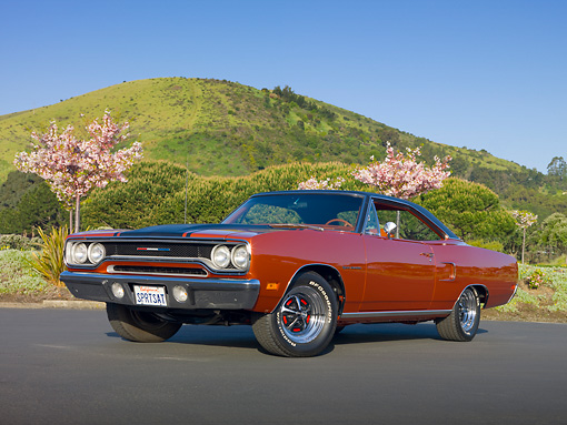 AUT 23 RK1974 01 © Kimball Stock 1970 Plymouth Sport Satellite Burnt Orange 3/4 Front View On Pavement By Cherry Blossom Trees