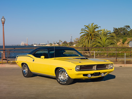 AUT 23 RK2000 01 © Kimball Stock 1970 Plymouth Barracuda 440 Six Pack Yellow 3/4 Front View On Pavement By Water And Palm Trees