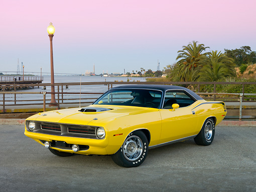 AUT 23 RK2001 01 © Kimball Stock 1970 Plymouth Barracuda 440 Six Pack Yellow 3/4 Front View On Pavement By Water And Palm Trees