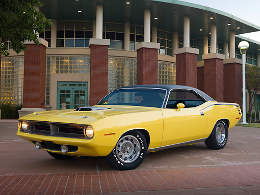 AUT 23 RK2003 01 © Kimball Stock 1970 Plymouth Barracuda 440 Six Pack Yellow 3/4 Front View On Pavement By Building